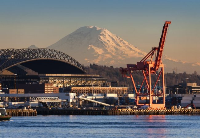 Mt. Rainier looms large over the Port of Seattle on Elliott Bay during a lovely winter sunset.